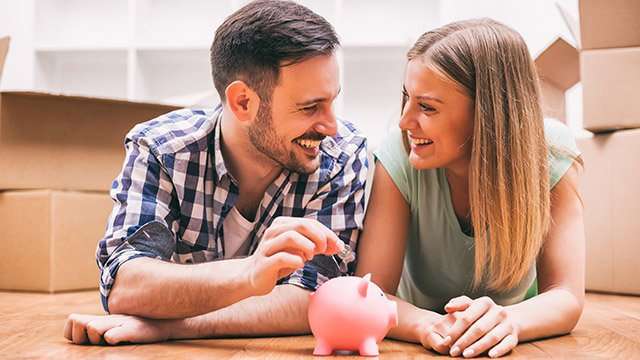 blog-preview_Couple on Floor Piggy Bank - 4 Ways to Save Money - CB.jpg
